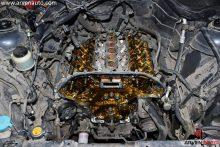 Процесс замены цепи ГРМ в двигателе V6. В данном случае процедура объединена с регулировкой клапанов, поэтому сняты распредвалы. Автомобиль – Infiniti FX35.